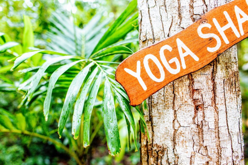 hanging brown and white yoga signboard