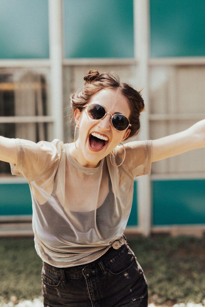 woman smiling raising her hands